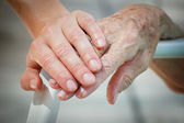 depositphotos 4548496 Young and old hand